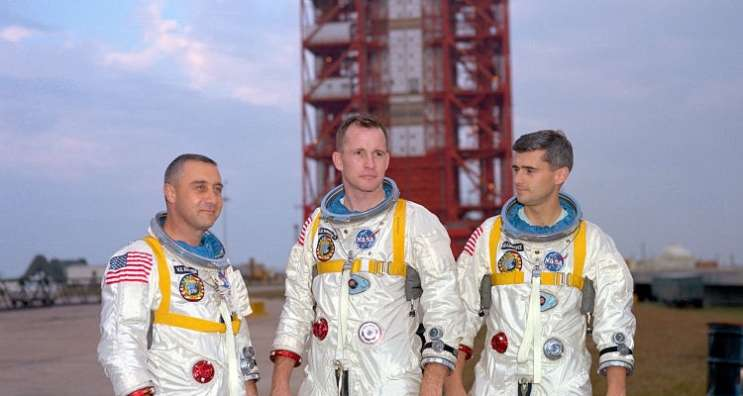 Astronauts (left to right) Gus Grissom, Ed White, and Roger Chaffee, pose in front of Launch Complex 34 which is housing their Saturn 1 launch vehicle. The astronauts died ten days later in a fire on the launch pad. Photo: NASA