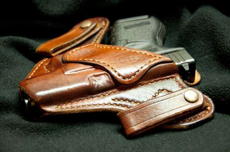 File photo: gun in holster