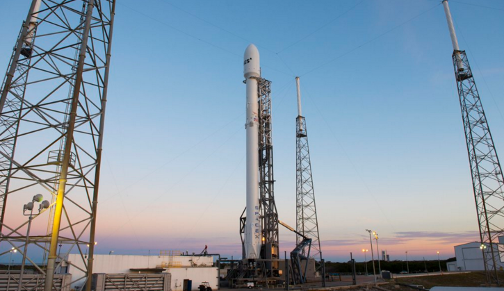 A Falcon 9 rocket with an SES-9 satellite wait on the pad